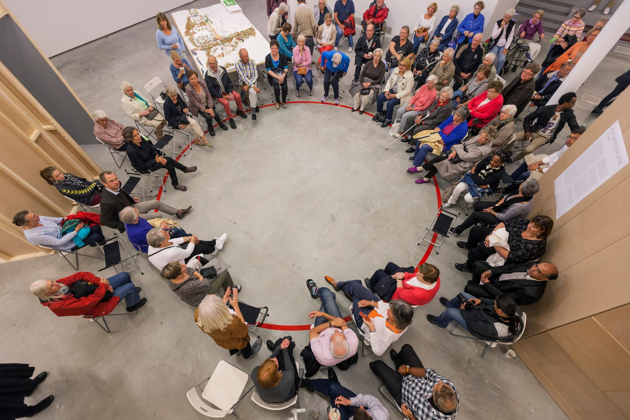 a circle of residents convened by the artist to discuss the shaping and design of their community